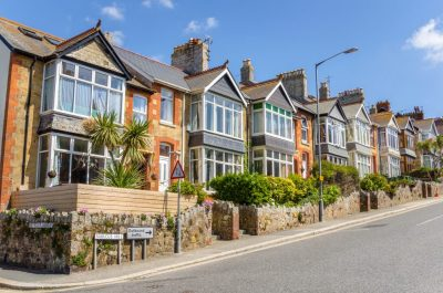 Row of houses on a residential street and street name visible, which could add value to your