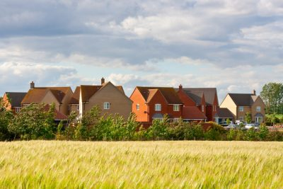 Residential houses with the countryside in the foreground.